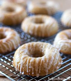 These Cinnamon Baked Doughnuts drizzled with Vanilla Bean Glaze are ridiculously delicious. Easy to make with everyday ingredients. #donuts #cinnamon #breakfast