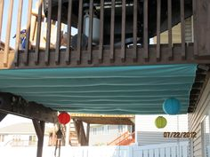 Ceiling to lower deck. Used 3 king sized sheets I bought from Target and a staple gun.  SUPER easy.