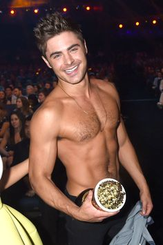 21 Photos of Zac Efron Looking Like a Human Ken Doll