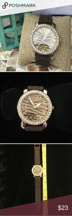 🆕 Brown zebra face silicon watch Brown zebra print face with rhinestones & silicon band watch - battery just replaced 11-16-16 works like a charm😊.                                ✅I ship same or next day ✅Bundle for discount Geneva Platinum Accessories Watches
