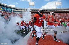 News Photo : The Oklahoma State Cowboys take the field before...
