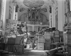 An American soldier views crates containing works of art looted by the Nazi regime in storage at a church in Ellingen, Bavaria in 1945.