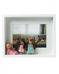 A scrapbox showing a little girls favorite dolls and a picture of her with her collection. Would also be great for a boy showing toy cars. From Darcy Miller - lot's more ideas if you click the link