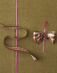 Cut length of ribbon; trim ends with pinking shears. Center larger ribbon on top of thin tying ribbon; larger ribbon should be on its side, forming a backward S-shape. Make sure loops are symmetrical. tie with smaller ribbon and fluff out bow