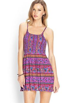 This cami dress features a folk-inspired print and smocked bodice. Finished with adjustable shoul...