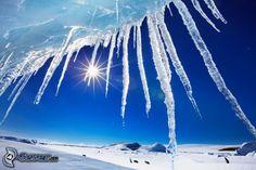 Eiszapfen, Sonne, verschneite Landschaft