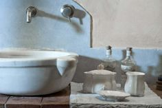 Everyone loves the feeling of history.  Love this image, the natural marble, old school taps and this gorgeous collection of hand made ceramics for the cloakroom. Toothbrushes never looked so chic. Also a perfect vase. Here's how to showcase your bathroom so it looks its best. Beautiful unusual amazing bathroom accessories. Design Is Inspired By Everything.