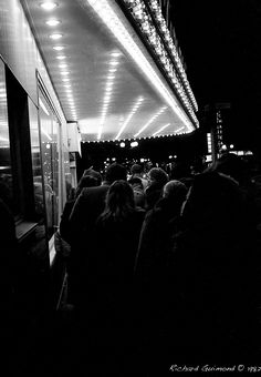 The Movie Starts in 5 Minutes;  Photo by Richard Guimond ©1982 19821214 017 (3)f  Nikon F2a 35mm f2.8 Hp5 Microphen