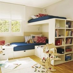 If a room's dimensions don't allow for separate beds, bookshelves, dressers, and toy storage, try a multifunctional approach. This bunk bed cleverly combines all of these elements into a single corner unit, leaving the middle of the room free for creative play.