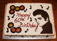 A Cake With Records And Blue Bows