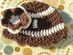 cute football hat for a baby girl!  Sending this to my sister in law to hopefully make... ;)