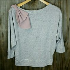 """""""LUSH """" Brand Sweater Top ~Gray with pink chiffon bow on left shoulder  ~Looks really cute with jeans ~56% cotton,  36% polyester,  8% rayon  ~Dry clean only Lush Tops"""