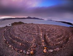 The Land's End Labyrinth - San Francisco, CA  Just a stone's throw from one of American's busiest populations centers, high on a windswept cliff, overlooking the San Francisco Bay, sits a labyrinth. A replica of the seven-circuit Chartres labyrinth, the one at Land's End is not on any maps, nor is it listed on any of the official Land's End park paperwork or websites. Created in 2004 by Eduardo Aguilera, who has built other, similar sites around the Bay Area, the place is amazing.