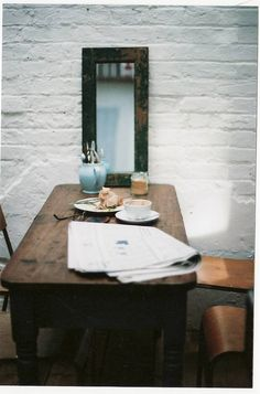 great table and mirror...but I would paint the wall sage green