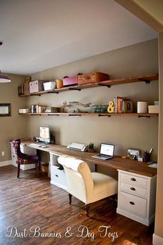 Nice DIY counter/desk, made with a long slab of wood, and some wooden nightstands/file cabinets.