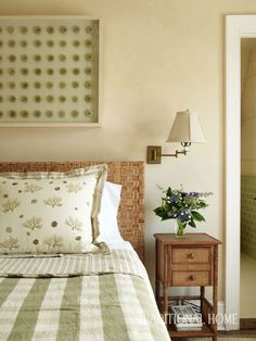 The soft green palette of the cottage's first floor carries upstairs to the guest room. - Photo: Tria Giovan / Design: Douglas Graneto