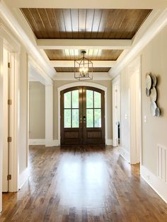 Grand Entrance Shiplap ceiling in foyer . Home Design, Shiplap Ceiling, Bathroom Wall Panels, Magic Garden, Double Entry Doors, Olive Garden, Garden Route, Foyer Decorating, Bathroom Trends