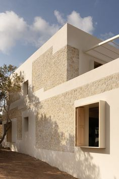 Architecture project by nomo studio a limestone house in minorca Design Exterior, Interior And Exterior, Stucco Exterior, Contemporary Architecture, Architecture Design, Limestone House, Stone Facade, Wooden Shutters, Wooden Doors