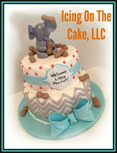"""""""Welcome Little Peanut""""!  Baby shower cake with chevron design and handmade fondant elephant topper.  www.facebook.com/icingonthecake1"""
