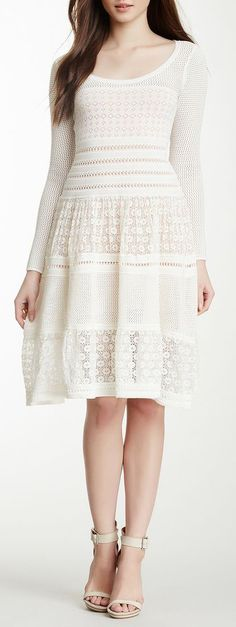 I have a green crochet with short sleeves. I love it, but I might like this one better. lace.Flare Dress
