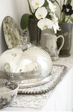 Great silver tray with a large silver cloche. I have these and use them all the time. JH