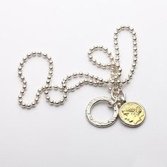 The ancient coin necklace features a replica of the 10 drachma coin used in ancient Greece.   A ring charm pendant is also included.    #jewelry  #necklace  #pendant