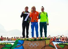 (L-R) Silver medalist Rachele Bruni of Italy, gold medalist Sharon van Rouwendaal of the Netherlands and bronze medalist Poliana Okimoto of Brazil pose on the podium during the medal ceremony for the Women's 10km Marathon Swimming on day 10 of the Rio 2016 Olympic Games at Fort Copacabana on August 15, 2016 in Rio de Janeiro, Brazil.