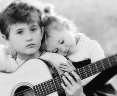 9 Images: Kid couple romantic girl and boy hug playing guitar
