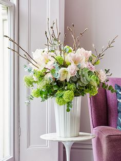 For a chic flower arrangement for Spring add shades of pink with a dash of lime… Fresh, with a modern twist. Try using Blush Sweet Avalanche and Faith roses, guelder roses and Nymph amaryllis, styled with natural magnolia branches.