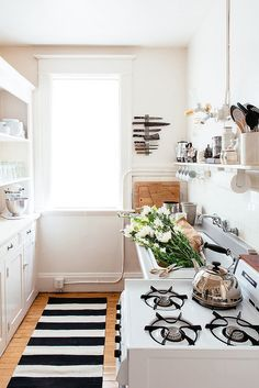 6 Instant Upgrades to Make to Your Rental Kitchen: #5 Throw Down a Runner. buying a carpet or runner can make for an easy fix. Just be sure to find something dark that won't show dirt or stains.
