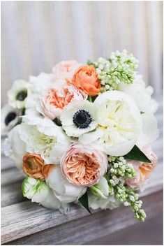 The bride will carry a clutch bouquet of White peonies, white anemones, Juliet garden roses, white lilacs, white ranunculus, green-white parrot tulips, white spray roses, and seasonal greenery wrapped in ivory ribbon with the stems showing