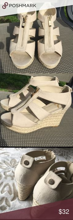 Report peep toe style wedges. Fabric upper. Front zip closure with gold tone zipper pull. Same gold buttons at back. Rope-wrapped platform and wedge for style and comfort. Rubber sol. Worn 2-3 times. Report Signature Shoes Wedges