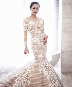 our beautiful bride wearing beautiful gown by Hian tjen