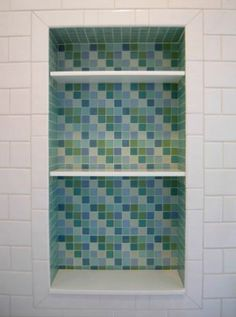 Recessed shelves inside the shower - so much nicer than balancing shampoo bottles precariously on the edge of the tub---Love the IDEA and the TILE Glass Tile Bathroom, Bathroom Niche, Bathroom Gallery, Shower Niche, Bathroom Windows, Bathroom Pictures, Glass Mosaic Tiles, Bathroom Renos, Small Bathroom