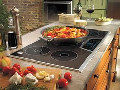 Induction uses an electro-magnetic field to heat stainless-steel or cast-iron cookware.  It offers: 1) The ease of electric with the power and control of gas. 2) Faster and more energy-efficient heating than standard electric. 3) A cool-to-the-touch top that won't burn the kids. 4) A pro-grade cooktop in an island without running gas lines. Just add an outlet.