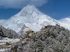"""Read a beautiful quote on Chris Burkard's gallery. """"If you are lucky enough to be in the mountains, you are lucky enough! Here is an image of Manaslu, the eighth highest peak in the world, located in the Nepalese Himalaya, it's the most beautiful peak I have ever layed my eyes on. The entrance of the Nyingmapa Monastery can be seen in the foreground. (This is a re-edit with of a previous shot I posted on here, I wasn't happy with the crop)"""