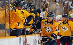 NASHVILLE, TN - OCTOBER 8: Viktor Arvidsson #38 of the Nashville Predators celebrates his first career NHL goal with the bench against the Carolina Hurricanes