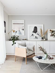 The norsuHOME - Living Room Photographer: Lisa Cohen Stylist: Beck Simon  Paint: Dulux Tranquil Retreat Cabinetry: kaboodle Kitchens Benchtop: Caesarstone Flooring: Godfrey Hirst  Panelling: EasyCraft  Products: GlobeWest Ingrid Chair & Como Coffee table, Love Warriors Sky Circles print, Donna Delaney Matilda Print, Middle of Nowhere prints, Armadillo & Co Sherpa rug (all available at www.norsu.com.au)