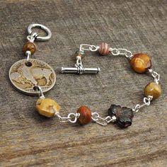 Buffalo coin bracelet, silver, earthtone beads, red creek jasper US nickel, 8 inches 20cm BY LAUREL MOON JEWELRY on Etsy.   $28.00