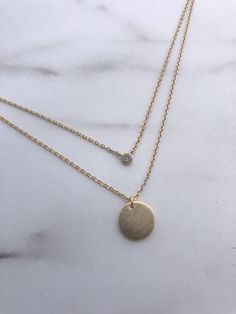 Double layered necklace on a dainty chain Light gold brushed disc pendant Tiny crystal pendant adds the perfect layered look to this delicate necklace chain with extender Dainty Necklace, Dainty Jewelry, Gold Necklace, Layered Necklace, Layered Look, Crystal Pendant, Delicate, Pendants, Chain