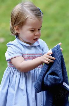 Princess Charlotte sorts out her cardi. Picture: Chris Jackson/Getty Images