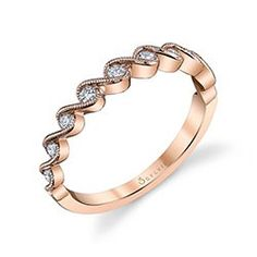 """Swirls+of+milgrain+beaded+ribbons+flow+around+dazzling+round+brilliant+diamonds+to+create+a+romantic+rhythm+on+this+magical+designer+wedding+band+in+shiny+rose+gold.++Place+this+alluring+band+next+to+your+elegant+engagement+ring+as+a+wedding+set+or+stack+it+with+other+favorite+bands+of+different+designs,+colors,+and+texture+to+create+your+own+fashion+look.++The+total+weight+of+this+""""must-have""""+band+is+0.21+carats."""
