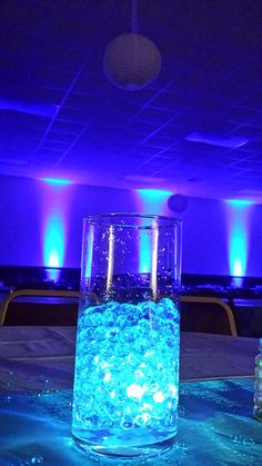 Blue uplights create a gorgeous backdrop for this blue wedding #diyuplighting