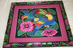 Kuna Mola. hand stitched art work, framed in unique hand painted frame created to match the mola by Dominique Rice and signed. asmatcollection on ebay and Bonanza.com cheetahdmr@aol.com