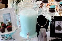 Tiffany Blue Punch - 1 Gal. Blue Hawaiian Punch, 1 Can chilled sweetened condensed milk, mix w/elec mixer until foamy, serve over ice