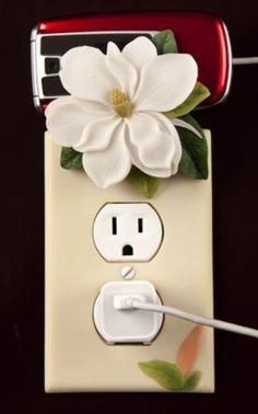 Magnolia Outlet Cover & Cell Phone Holder By Ibis & Orchid Design Collection Ibis & Orchid http://www.amazon.com/dp/B00420EON8/ref=cm_sw_r_pi_dp_HzEEub196P3H6