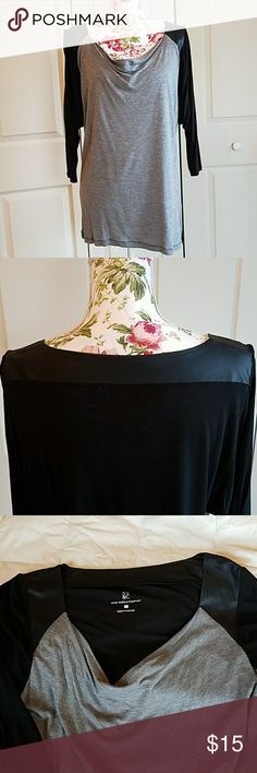 Trendy Top with Faux Leather Shoulders Slightly stretchy top with faux Leather shoulder trim that rubs across the back. Great condition. Heather grey and black. New York & Company Tops Blouses
