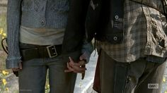 She didn't just hold his hand-- he held hers. Bethyl.  The Walking Dead.