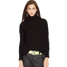 One of five fabulous winter fashion trends: the black turtleneck sweater.