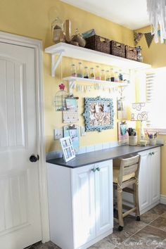 Craft Room - maybe something like this in the home office for crafties, wrapping, packaging, etc? Possibly using cabinets from the old house instead of getting rid of them?
